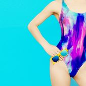 picture of swimsuit model  - Girl model in bright fashionable swimsuit on blue background - JPG