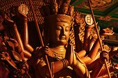 stock photo of yin  - Guan Yin sculpture Thousand Hand carved of wood - JPG