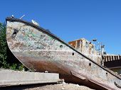image of pontoon boat  - The old rusty ship on the river bank Volga in the city of Volgograd - JPG
