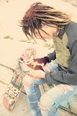 image of dreadlocks  - Cropped image male freelancer with dreadlocks sitting with digital tablet typing message warm filter applied - JPG