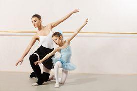 picture of ballerina  - Little ballerina dancing with ballet teacher in dance studio - JPG