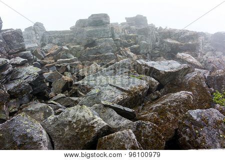 Jagged Rocks Piled Up In Fog
