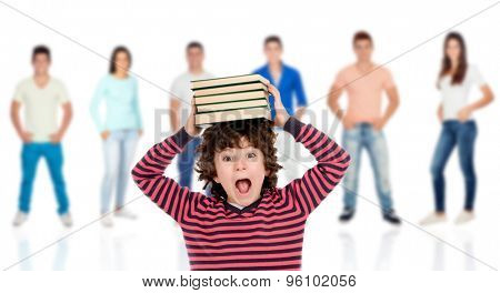 Crazy child with books on his head and people unfocused background