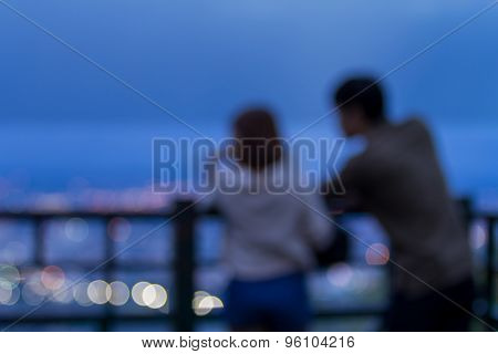 Blurred Young Couple And City Light From Viewpoint
