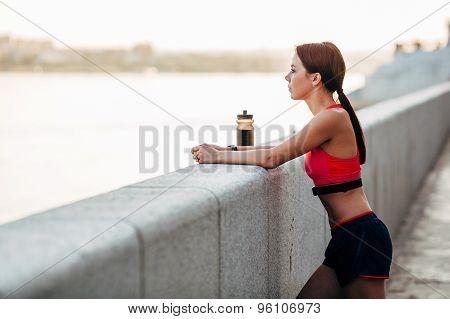 Female runner with bottled water