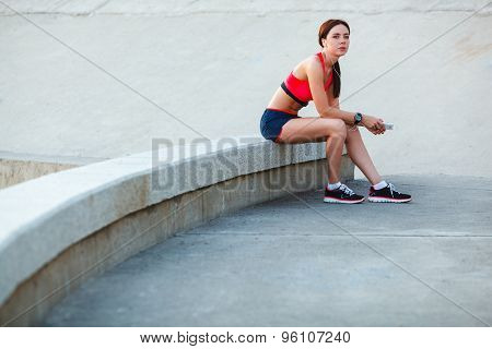 sitting tired sporty woman
