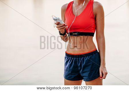 runner woman listening music
