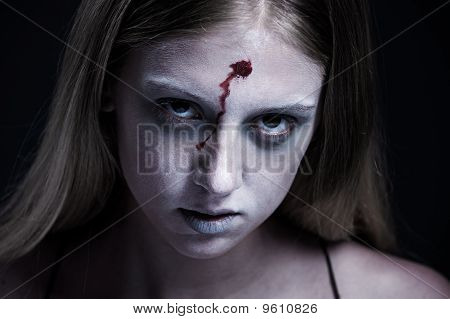 Portrait Of Zombie With Wound On Forehead