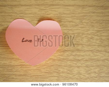Love You, Writing On Sticky Note, Heart Shape On Wood Background