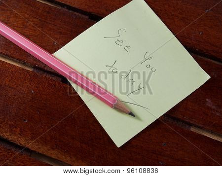 See You Today, Writing On Yellow Sticker Paper And Pink Pencil On Wood Background