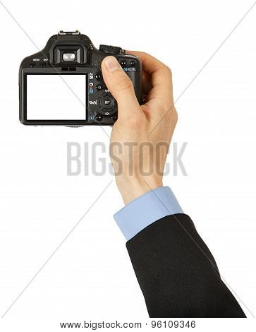 Black Photo Camera With Clipping Path For The Screen In A Man's Hand