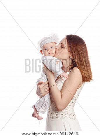 A Mother Kisses Her Daughter. Isolated.