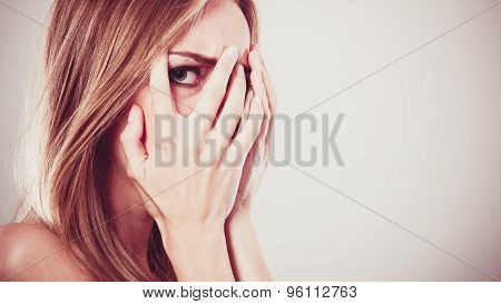Afraid Frightened Woman Peeking Through Her Fingers
