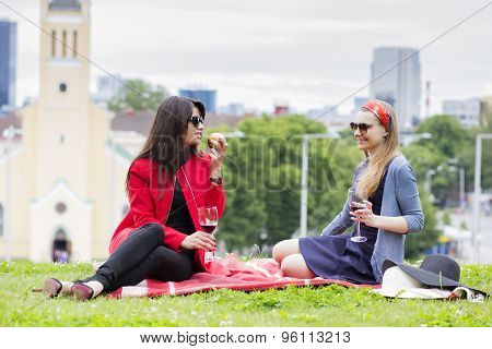 Young Girls Are Enjoying The Afternoon Picnic