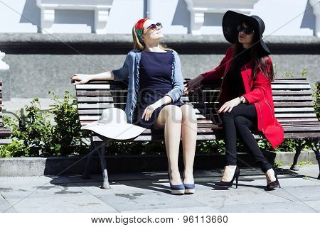 Blondie Sunbathing While Brunette Hiding Under Hat