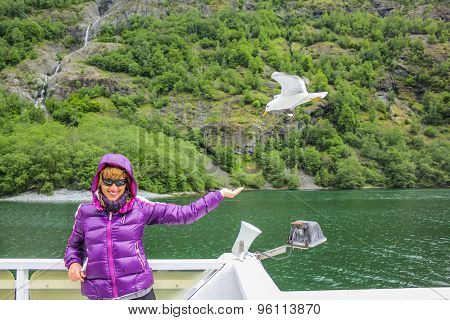 Woman feeding seagull