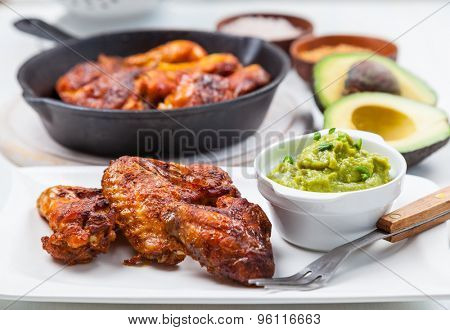 Grilled chicken legs and wings with guacamole, frish salad and spicies