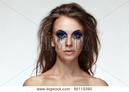 Woman With Blue Fantasy Make Up On Eyes