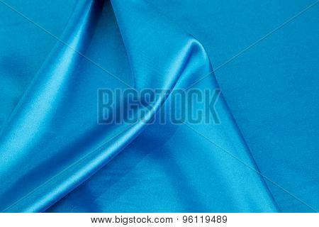 Some soft folds of light blue silk cloth.