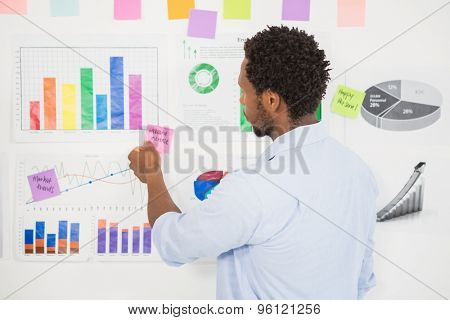 Young businessman with charts