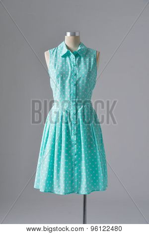 female blue sundress on mannequin-gray background