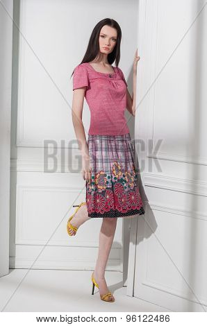 full-length high young fashion model posing in the studio