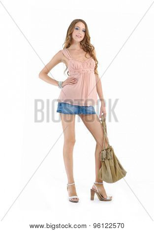full-length Portrait of fashion model holding handbag posing nd