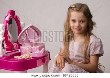 portrait of the beautiful little girl in a pink dress