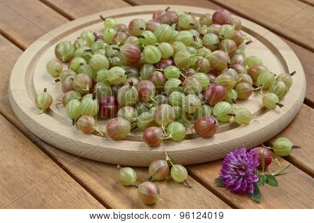 Gooseberries On Wooden Plate And Background