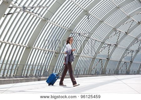 Smiling Business Woman Walking With Bag At Station