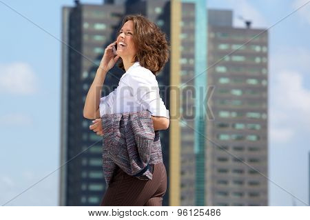 Happy Business Woman Walking And Talking On Cell Phone