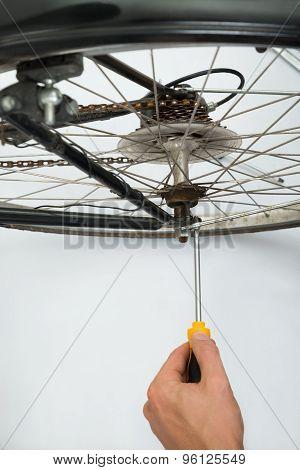 Person Repairing Bicycle Wheel