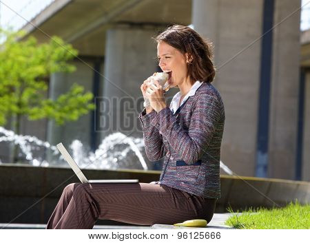 Business Woman Eating Food During Lunch Break