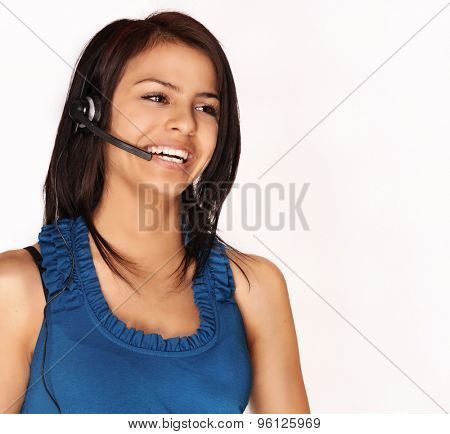 Attractive smiling kind young woman helping customer on phone