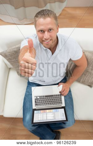 Man Showing Thumb Up With Laptop