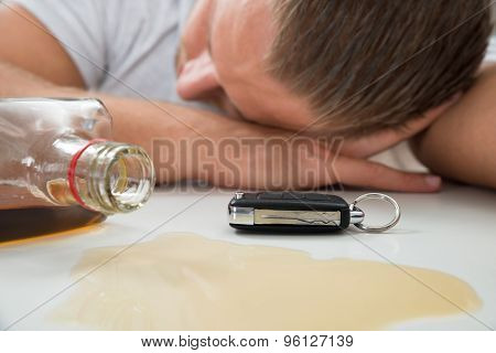Man With Glass Of Liquor And Car Key