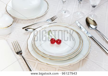 Two Cherries Lie On A White Porcelain Plate