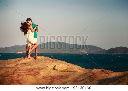 Girl And Guy Kiss Against Mountains