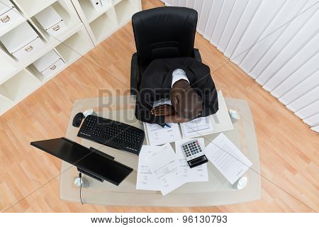 Tired Businessman At Desk