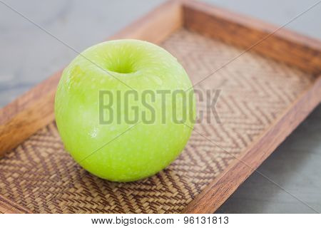 Green Apple On Wooden Tray