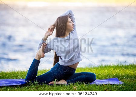 Beautiful Sporty Young Woman Working Out On Riverbank