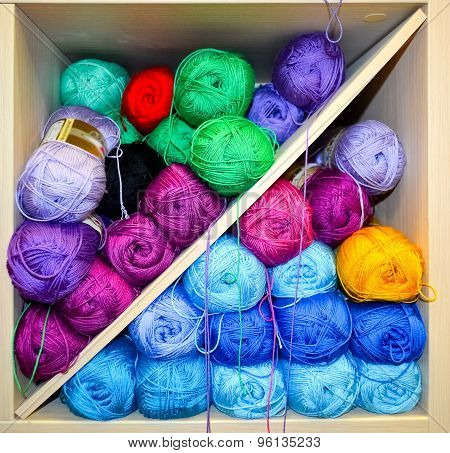 Shelf With Knitting Yarn Balls