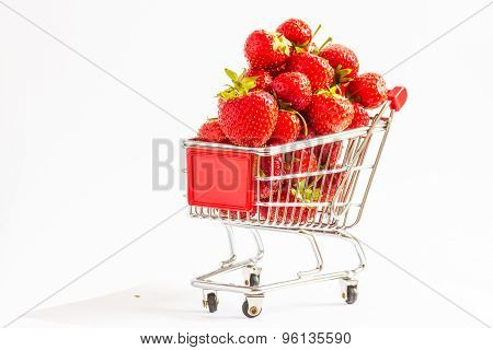 Miniature shopping cart with strawberries