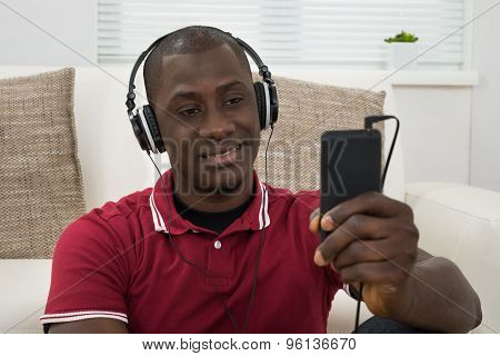 Young Man Listening Music On Headphones