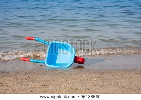 Wheelbarrow Carries Water From The Sea
