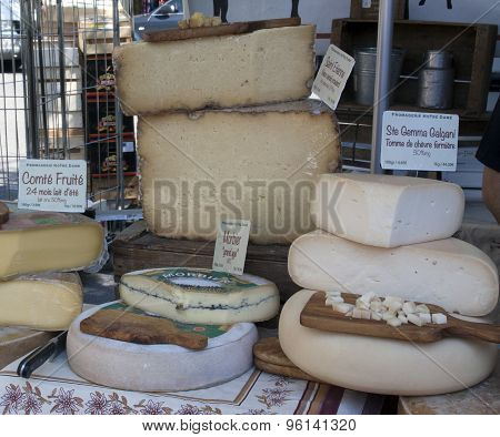 French Cheese Displayed For Sale At The Market In Arles France