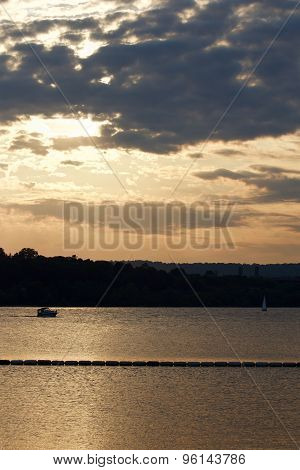 The Sunset On The Lake With Two Yachts