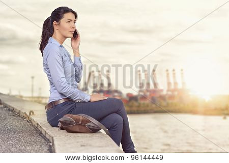Attractive Woman Talking On Her Mobile Phone