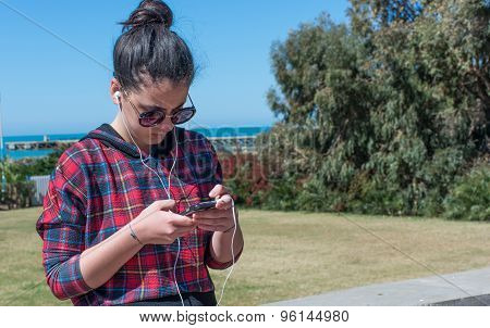 Girl Listen To Music From Your Smartphone.