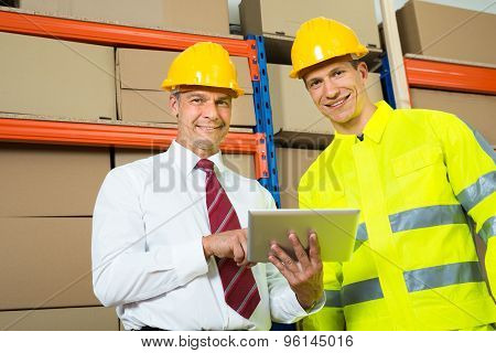 Portrait Of Happy Warehouse Worker And Manager